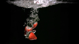 Strawberries dropping in super slow motion Stock Video Footage