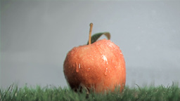 Red apple in super slow motion getting wet Stock Video Footage