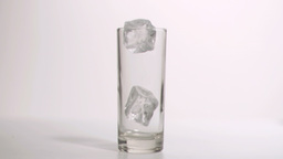 Ice cubes in super slow motion placed in a glass Footage