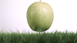 Apple dropping in super slow motion on the grass Stock Video Footage
