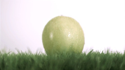 Apple dropping in super slow motion on the grass Footage
