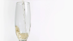 Sparkling wine splashing in super slow motion in a Stock Video Footage