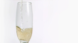 Champagne in super slow motion splashing in a flut Footage