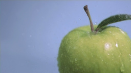 Water in super slow motion falling on an apple Footage