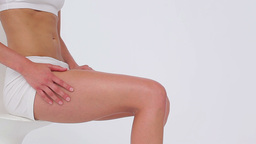 Peaceful woman massaging her legs Stock Video Footage