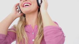 Smiling blonde woman wearing headphones Footage