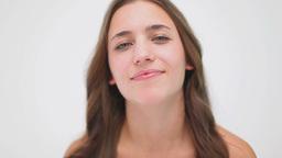 Smiling brunette massaging her neck Stock Video Footage