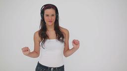 Smiling woman dancing while wearing headphones Stock Video Footage