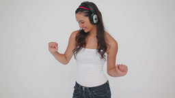Smiling woman dancing while wearing headphones Footage