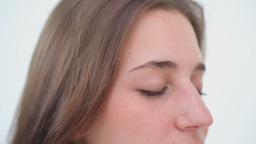 Peaceful woman brushing her brown hair Footage