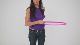 Happy woman playing with a hulahoop Stock Video Footage