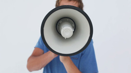 Angry young man using a megaphone Footage