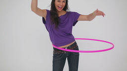 Smiling woman playing with a hula hoop Footage