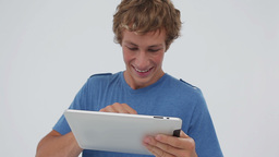 Smiling young man using a tablet computer Footage