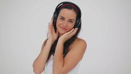 Peaceful woman wearing her headphones Footage