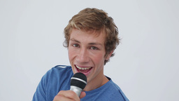 Happy young man playing karaoke Stock Video Footage