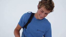Happy young man holding his backpack Stock Video Footage