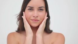 Peaceful woman massaging her cheeks Stock Video Footage