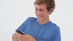 Smiling brunette man texting on his cellphone Footage