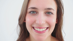 Cheerful woman using lip balm on her lips Stock Video Footage