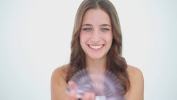 Happy brunette woman playing with a metal spring Stock Video Footage