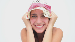 Happy brunette woman holding her hat Footage