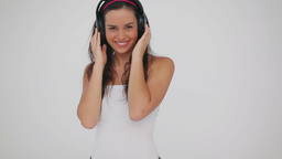 Happy brunette wearing headphones Footage
