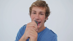 Happy young man singing with a microphone Stock Video Footage