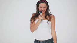 Happy brunette woman dancing while singing Footage