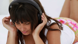 Peaceful young woman listening to music Footage