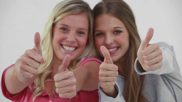 Smiling young women placing their thumbs up Footage