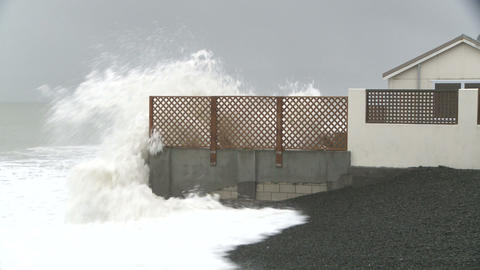 stormy sea pounds coastal property Stock Video Footage