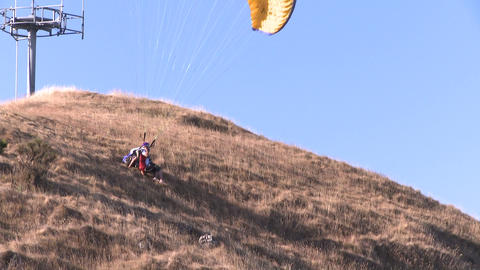 tandem paraglider liftoff Stock Video Footage