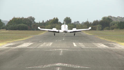 twin prop plane lands Footage
