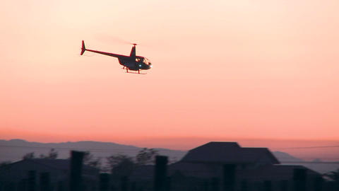 two helicopters in pre dawn sky Stock Video Footage
