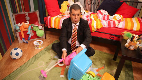 Mature man playing in children;s bedroom Stock Video Footage