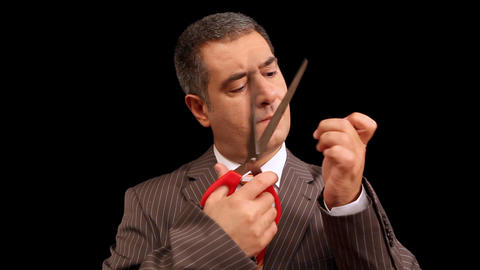 Businessman cutting nails Stock Video Footage