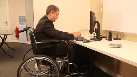Cheerful businessman with wheelchair Stock Video Footage