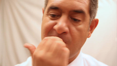 Businessman biting nails Stock Video Footage