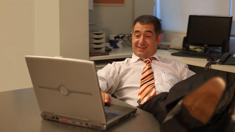 Businessman working on laptop in office Stock Video Footage