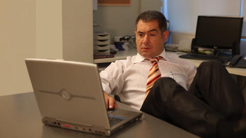 Businessman working on laptop in office Footage