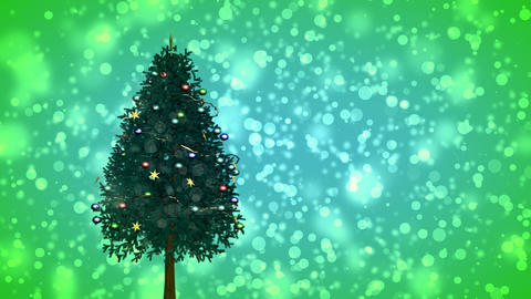 Spinning Christmas tree on green snowy background Stock Video Footage