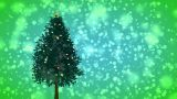 Spinning Christmas Tree On Green Snowy Background stock footage