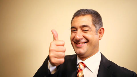 Businessman giving thumbs up, gun and surrendering Footage