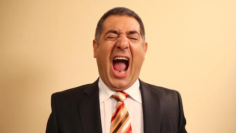 Tired businessman yawning and stretching Footage