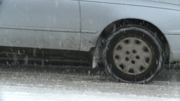 HD2008-12-7-5 snow traffic spinning tires Stock Video Footage