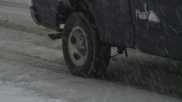 HD2008-12-7-15 snow traffic spinning tires Stock Video Footage