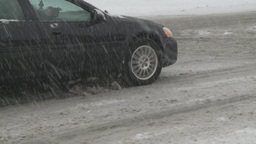 HD2008-12-7-19 snow traffic spinning tires Stock Video Footage