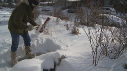 HD2008-12-7-29 TL snow shovel walk Stock Video Footage