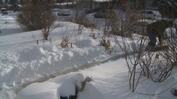 HD2008-12-7-29 TL snow shovel walk Stock Video Footage